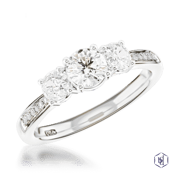 round brilliant cut platinum three stone diamond band engagement ring