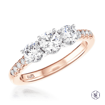 round brilliant cut 18ct rose gold shank and platinum head three stone diamond band engagement ring